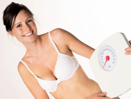 desired: young woman with a weight scale Stock Photo