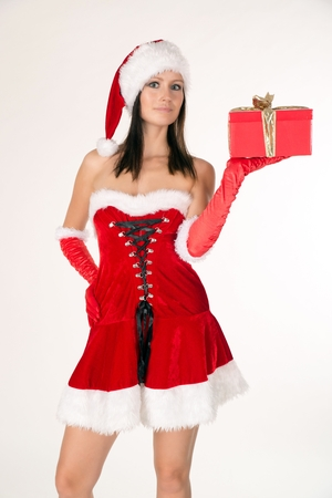 christmas costume: young woman in a Christmas costume and a gift