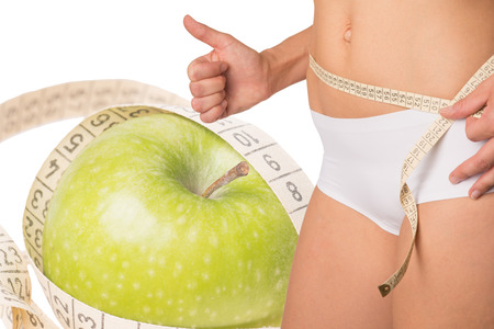 belly band: Woman measuring her waist circumference Stock Photo