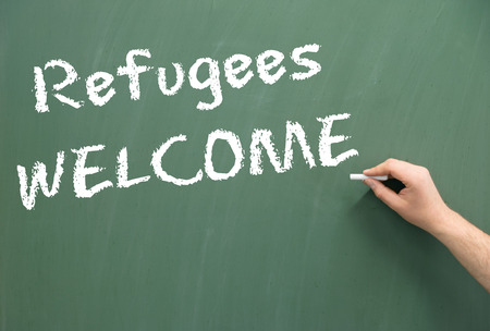 persecution: Chalkboard with the words Refugees Welcome