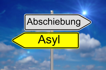 persecution: Sign with the german words Deportation and Asylum