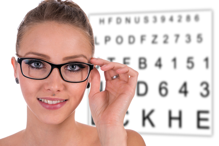 nearsighted: pretty woman wearing glasses