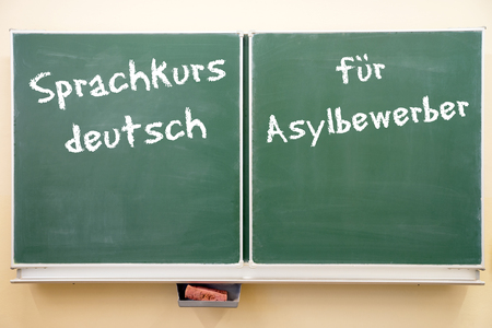 naturalization: Sign with the german words German language course for asylum seekers