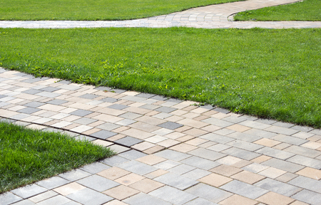 paved: paved path and green meadow