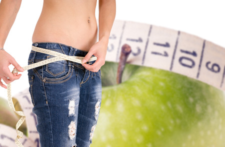 belly band: slender woman with a apple and measure tape Stock Photo