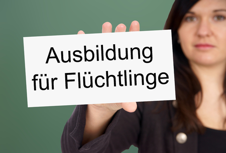 persecution: Woman and Sign with the german words Education for Refugees