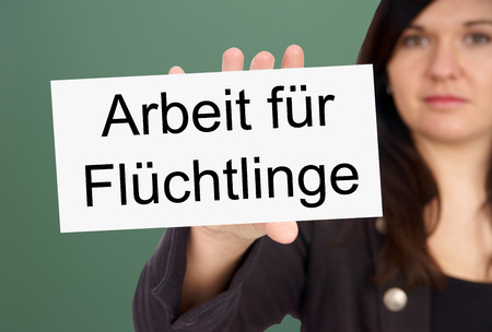 Woman and Sign with the german words Working for Refugees photo