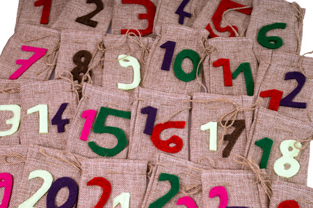 christkind: Advent Calendar of twenty four burlap sacks