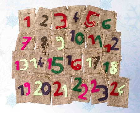 Advent Calendar of twenty four burlap sacks
