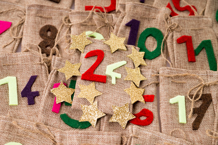 christkind: Advent Calendar of many jute bags