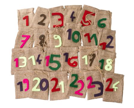 Advent Calendar of twenty four burlap sacks isolated over a white background