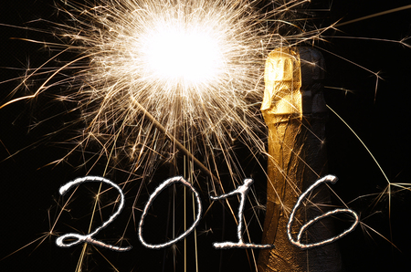 glow pyrotechnics: Champagne bottle with fireworks and the year number 2016 Stock Photo