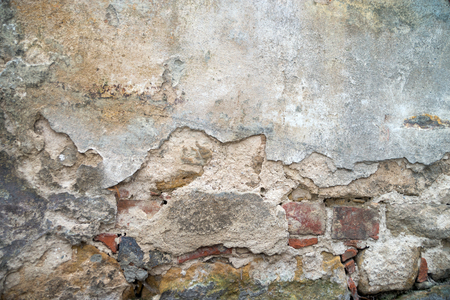finery: stone wall with a broken finery Stock Photo