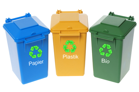 exempted: three Dustbins with the german words Paper, plastic and organic isolated over a white background