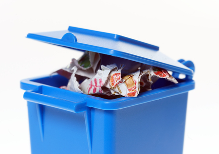 discard: blue paper bin with paper waste