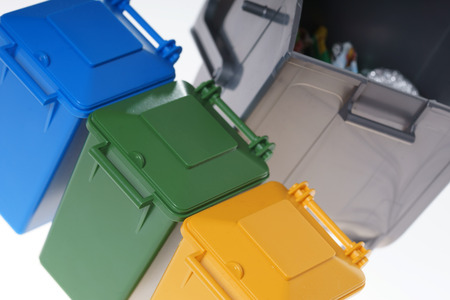 discard: Dustbins in the colors blue, yellow , green and silver