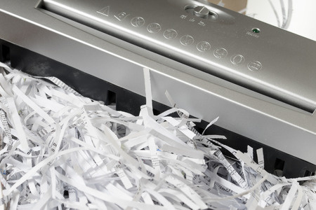 Scraps of paper from a paper shredder Banco de Imagens