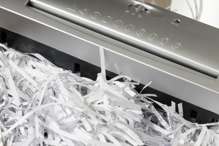 paper shredder: Scraps of paper from a paper shredder Stock Photo