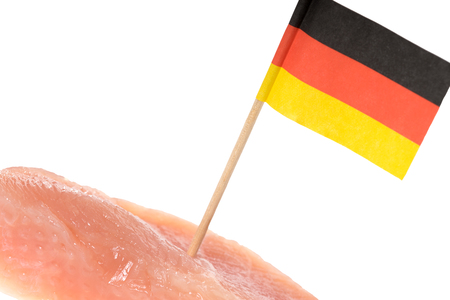 production facility: turkey steak with germany flag over a white background