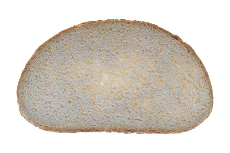 exempted: a slice of brown bread isolated over a white background Stock Photo