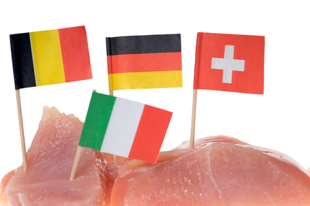 aliments: turkey steak with different flags over a white background