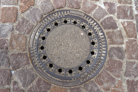 gully: Drain cover on a street Stock Photo