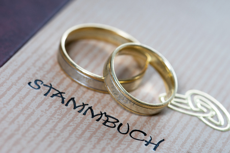 affiliation: Family Album of the family and two wedding rings Stock Photo