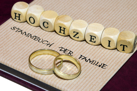affiliation: Family Album of the family and two wedding rings with wooden cubes with the german word wedding
