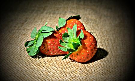 biologically: Strawberries lies on jute fabric