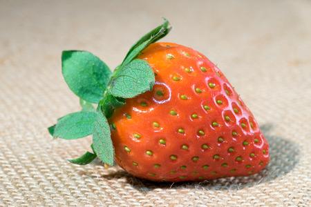 biologically: Strawberry lies on jute fabric Stock Photo