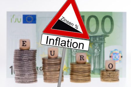 euro money: Sign with the german words interest and inflation in front of euro money Stock Photo