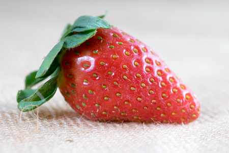 biologically: Strawberry lies on jute fabric Stock Photo