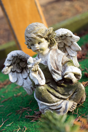 bereavement: little Angel on a cemetery Stock Photo