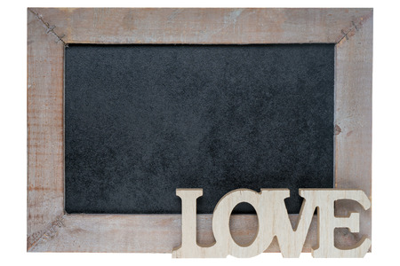 cordial: Wooden blackboard with wooden letters and the word Love