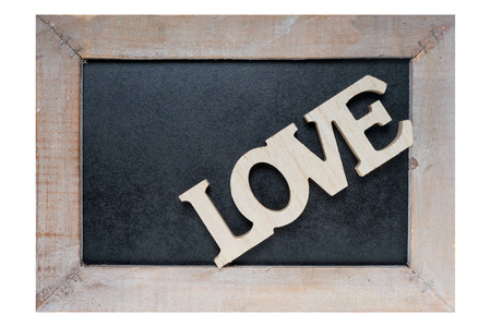 exempted: Wooden blackboard with wooden letters and the word Love