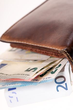 household money: Wallet with many euro banknotes