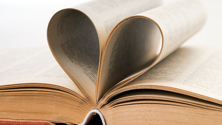 reading material: old book with heart