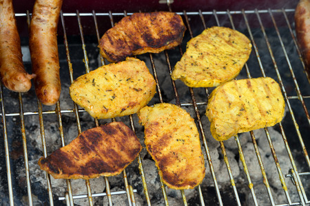charcoal grill: Meat and fried sausage on a charcoal grill