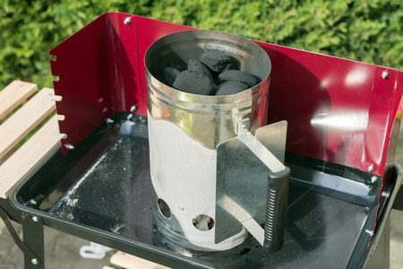 charcoal grill: coal lighter on a charcoal grill