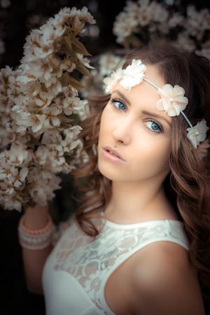 hair band: pretty woman with flower hair band in front of a blossoming apple tree