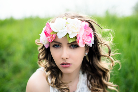 harbinger: pretty woman with flower hair band in nature
