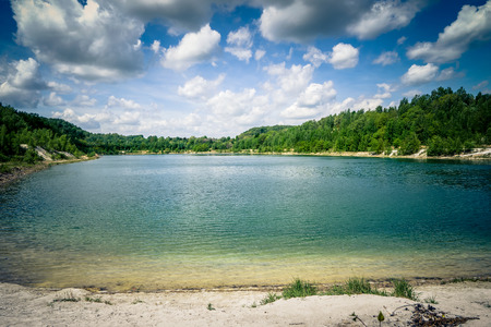 unaffected: beautiful lake with trees and wonderful clouds Stock Photo