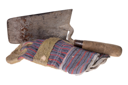 remuneraci�n: Brick trowel with work gloves isolated over a white background Foto de archivo