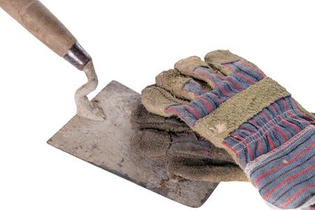 remuneraciÓn: Paleta de ladrillo con guantes de trabajo Foto de archivo