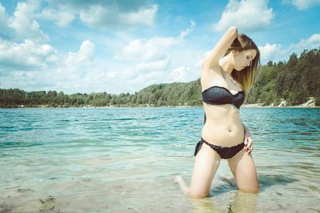 leisure wear: pretty woman in black bikini