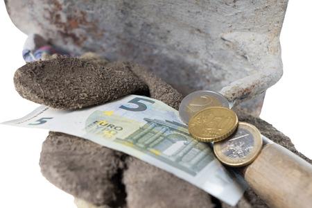 remuneraciÓn: Paleta de ladrillo con guantes de trabajo de ocho del euro cincuenta Foto de archivo