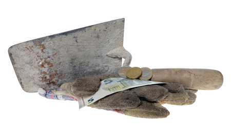 geldschein: Brick trowel with work gloves and eight euro fifty isolated over a white background