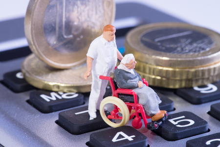 reimbursement: old woman in a wheelchair and their carer Stock Photo