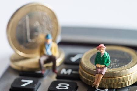 pension cuts: Pensioners sitting on Euro coins