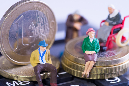 Pensioners sitting on Euro coins